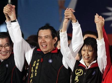 Taiwan President and Nationalist Party (KMT) presidential candidate Ma Ying-jeou and First Lady Christine Chow Mei-ching celebrate in Taipei
