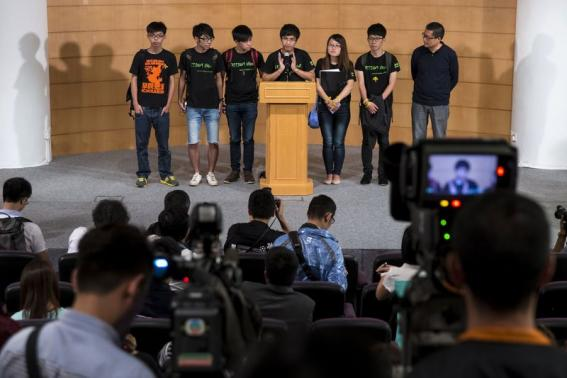 One of the founders of the Occupy Central civil disobedience movement Chan Kin-man and student leaders attend a news conference after meeting with senior Hong Kong government officials in Hong Kong